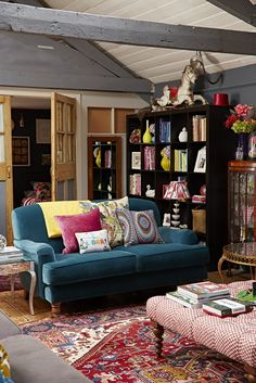 Sophie Robinson interior design living room with Teal sofa in open plan loft aprtment in central brighton