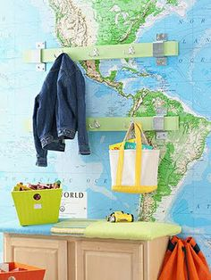 "I like the idea of the map ""wallpaper"" above a desk. Combine this with the orange kids workspace I have on my board, paint the walls a different color and put the maps as a backdrop. Hmmmm."