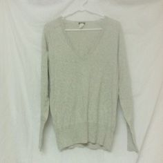 Soft Long Sleeve Grey J. Crew V Neck Top This cute J. Crew grey v-neck is perfect to wear alone, with a scarf, a vest, or a sweater! It is in good condition and it's a size medium! It is also nice and soft! J. Crew Tops