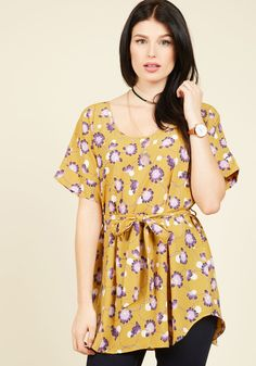 "<p>Zoom in on that group shot to admire yourself in this delightful, mustard yellow tunic! Boasting black circles and lilac blossoms - a print that's exclusive to ModCloth - and a coordinating sash, this breezy scoop neck top forms a picture-perfect look. Love this long layer? Check it out in <a href=""http://www.modcloth.com/shop/search?keyword=Medium+Format+Memory+Tunic"">a host of other hues!</a></p>"