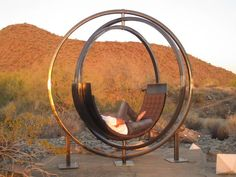 Gyroscope recalling outdoor lounge chair, called Etazin, is made of three solid steel rings. The outermost ring is stationary, creating a framework so the two inner rings can spin. A curved, padded lounge chair sits on the innermost ring. Outdoor Lounge, Outdoor Chairs, Outdoor Living, Outdoor Decor, Lounge Chairs, Unique Furniture, Garden Furniture, Outdoor Furniture, Deco Cool