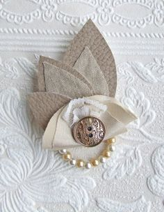 Taupe & Gold Leaf Buttonhole Leaves are cut from beautiful taupe faux leather complimented with gold flecked cotton fabric leaves with gold satin, white lace and decorative gold button embellished with a string of pearls.  www.ruffledruby.com