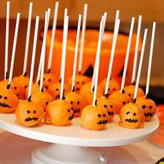 Dunkin Donuts Munchkins covered with Orange Chocolate for Pumpkin Pops or White Chocolate for Ghost Pops!
