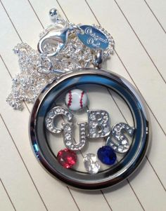Origami Owl Cubs Locket. Contact me to place your order: hmyers2778@yahoo.com charmedbyholly.origamiowl.com Repin and Share!