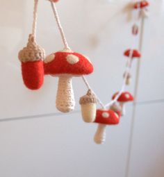 Mushrooms acorns garland felted wool crochet toadstools red white Alice in Wonderland decorations Waldorf toy woodland nursery decor gift by astashtoys on Etsy https://www.etsy.com/listing/115635229/mushrooms-acorns-garland-felted-wool