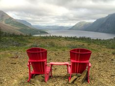 A pair of adirondack chairs at the Trout River Pond viewpoint, with the Tablelands and cliffs lining foggy Trout River Pond in Gros Morne National Park. Gros Morne, Lake George Ny, Newfoundland And Labrador, The Next Big Thing, Canada, Parcs, Florence Italy, Animal Shelter, Trip Planning