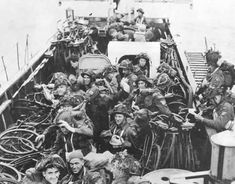 Canadian Troops and their bicycles aboard their landing craft at Juno Beach