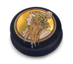 A Limoges Art Nouveau Porcelain Box, Tressemanes & Vogt of circular form, decorated with Tetes Byzantines after Mucha, having T&V Limoges France mark. Diameter 8 inches.