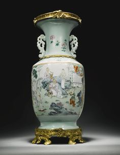 AN ORMOLU-MOUNTED CHINESE PORCELAIN FAMILLE-ROSE BALUSTER VASE, THE PORCELAIN QING DYNASTY, QIANLONG PERIOD (1735-1796), THE MOUNTS MID 18TH CENTURY.