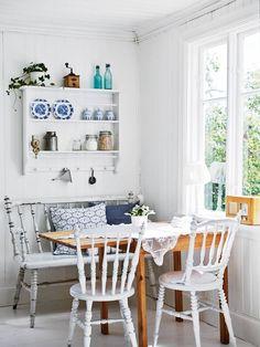 Cozy breakfast nook with rustic, coatsal decor influences