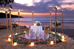 Love the dressed up chairs, the sand candles, and flowers on the table.
