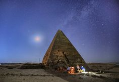 An almost full moon rises over an ancient pyramid in Karima, Sudan ©Greg Metro