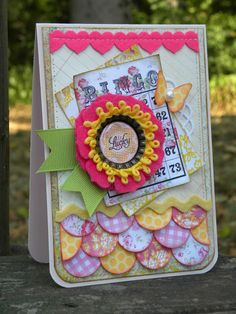 I like how the flower could also be taken for a medallion or an award ribbon. Nice bright cheery colors.