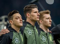Mesut Oezil Mario Gomez and Marco Reus of Germany sing the national anthem prior to the International Friendly match between Germany and England at...