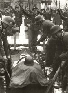 ■ Jochen Peiper salute on the coffin that holds of SS-Obersturmführer Lucas Westrup, in a funeral attended by officers of the Waffen-SS Leibstandarte, February 26, 1943. Westrup was a company commander of 12.SS division killed near Krasnograd two days earlier. He was promoted posthumously to SS-Hauptsturmführer.