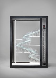 dutch studio jelle mastenbroek introduces the glassworks vending machine, as part of the 'money bank guarantee' series which questions the value of money.