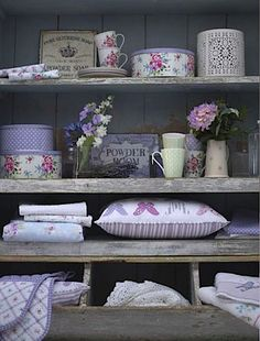 old lumber sheleves with floral accents...cute and cozy especially put in a bathroom