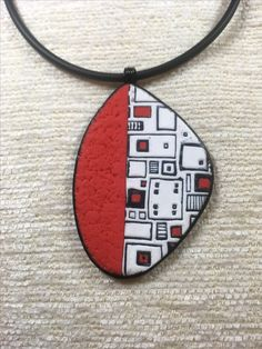 By Debby Wakley Pixilated pendant, red, white & black. Sutton slice using a Judikins texture sheet & Premo polymer clay