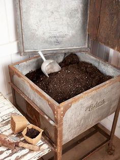 An old washtub, complete with a lid, is a perfect potting soil storage bin. - An old washtub, complete with a lid, is a perfect potting soil storage bin. Its large size accommod - Greenhouse Shed, Greenhouse Gardening, Container Gardening, Greenhouse Benches, Greenhouse Shelves, Backyard Beekeeping, Garden Compost, Container Plants, Potting Sheds