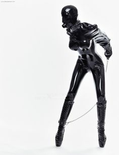An armbinder for the latex-clad Sandrine Rouche of www.latexeperiment.com