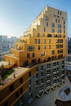 Paris' tallest housing block in over 40 years is clad with gold and silver metal Residential tower in Paris by Hamonic + Masson & Associés and Comte Vollenweider Architectes Futuristic Architecture, Facade Architecture, Residential Architecture, Amazing Architecture, Contemporary Architecture, Building Facade, Building Design, Building A House, Habitat Collectif