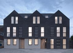 Denizen Works references traditional fishing huts with this apartment building in the English seaside town of Whitstable, which features black brick walls Architecture Today, Brick Architecture, Classical Architecture, Residential Architecture, Black Brick Wall, Townhouse Designs, Brickwork, Facade House, Building
