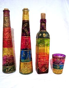 Garrafas e porta-velas / Bottles and candle holder by Lúcia Russo