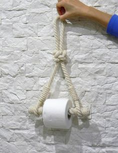 The toilet paper holder is made of natural Cotton Rope. Bathroom accessories in a marine style. This Cotton rope toilet roll holder is ideal for a nautical bathroom, coastal style cloakroom or beach house. Thickness of a thick rope for dressing Nautical Bathrooms, Modern Bathroom Decor, Bathroom Interior, Deco Marine, Diamond Knot, Diamond Rings, Rope Decor, Toilet Roll Holder, Bathroom Ideas