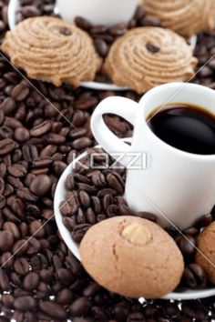 white coffee cup with beans with cookies. - Close-up shot of white coffee cup with beans and cookies.