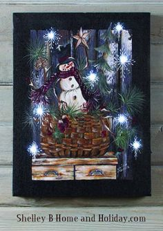 Add ambience to your surroundings with this lighted winter-themed wall art presented on quality canvas for long-lasting enjoyment. Christmas Wall Art, Christmas Signs, Outdoor Christmas, Christmas Crafts, Christmas Ideas, Christmas Decorations 2017, Basket Lighting, Lighted Canvas, Primitive Snowmen