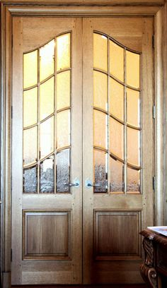 French interior glazed doors that are constructed with a particular joint in which the curved muntins nest