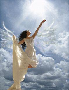 Woman like and angel reaching to heaven. David Perera