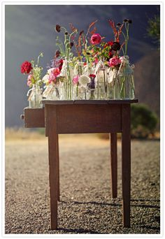 flowers in vintage bottles, select a vase and take it to your table with Arrangement Table Flowers, My Flower, Wild Flowers, Beautiful Flowers, Flower Jars, Rustic Flowers, Glass Flowers, Fresh Flowers, Colorful Flowers