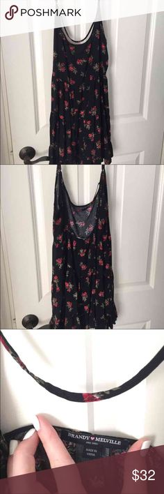 Selling less on merc! Brandy Melville sundress One size fits all  Rose pattern Black  Adjustable straps  Worn once perfect condition!  Selling because I need the money:)    Brandy Melville. Urban Outfitters. Nordstrom. American Eagle. Abercrombie. ASOS. Forever 21. American apparel Brandy Melville Dresses