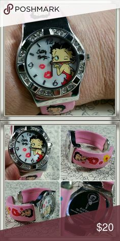"Betty Boop watch Licensed Betty Boop bracelet watch. Band is spring loaded. All crystals are intact and and I just put a brand new battery in it! Will fit small wrist best. I wear a 7"" bracelet and it fits me comfortably. Please see photo for blemish on one side of band. Great used condition otherwise. Betty Boop Jewelry"