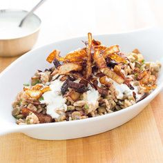 Rice and Lentils with Crispy Onions (Mujaddara) by America's Test Kitchen -- Mujaddara, the rice and beans of the Middle East, is a hearty one-dish vegetarian rice and lentil pilaf containing large brown or green lentils and crispy fried onion strings.