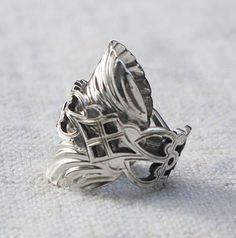 Neat idea.  Antique teaspoon into a ring.