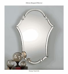 Olivia Shaped Mirror. gracefully arched and beveled mirror is ideal for vanity areas and as focal points above furniture. This shape makes a beautiful center for a gallery arrangement of wall decor.