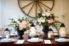 Gorgeous flowers. Perfect for a country wedding. Wagon wheel- make it a wish tree?