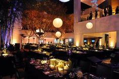 The Hammer Museum's 10th annual Gala in the Garden was held in Los Angeles on October 6. The tables, featuring floral arrangements by Dandelion Ranch, were covered in black velvet and topped with mirrored glass hurricanes containing square pillar candles and surrounded by bud vases filled with spider mums, air plants, and ferns.
