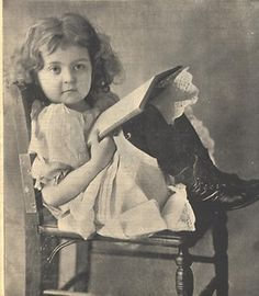 "Victorian photo of little girl reading a book, 1899. Looks like she's about to say ""What?"""