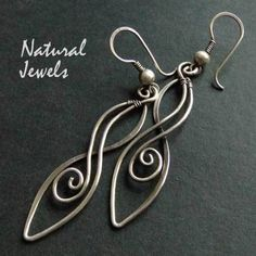 Earrings totally handcrafted from 925 Sterling silver wire.    An elegant and graceful ornament on a simple earhook, sometimes less is more.    - auth