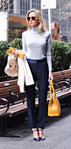 navy mary jane heels, ivory coat, grey turtleneck, navy silk pants, mustard gloves and bag