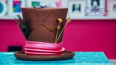 My Mad Matter's Hat Cake is perfect for anyone who is mad about chocolate! Layers of chocolate cake with delicious chocolate ganache. #Baking #Dessert