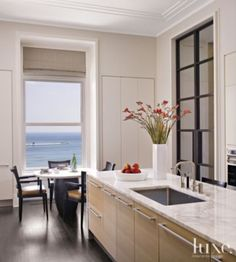 A Parisian-Inspired #chicago home's #modern #kitchen with Lakeside Views.   See MORE at www.luxesource.com.