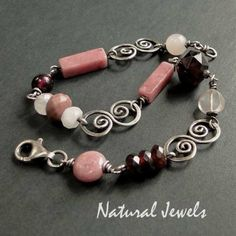 BRACELET by Natural Jewels Interesting combination of beads and shapes combined with pretty links