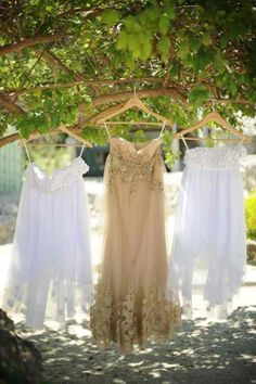 Sheer, light, and summer-y. The bride put on a champagne empire-cut gown accented with lace appliques and beads. Perfect for beach weddings. www.bridalbook.ph #beachweddings #weddingdress