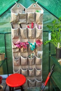 Reuse an old shoe organizer to store small gardening tools…