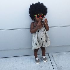 the cutest little girl // heart sunglasses, gray romper and sneakers
