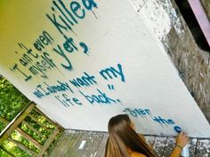 This is my friend Julia spray painting a Tyler The Creator quote photo credz to Hannah Taylor -- @itshanbanan21